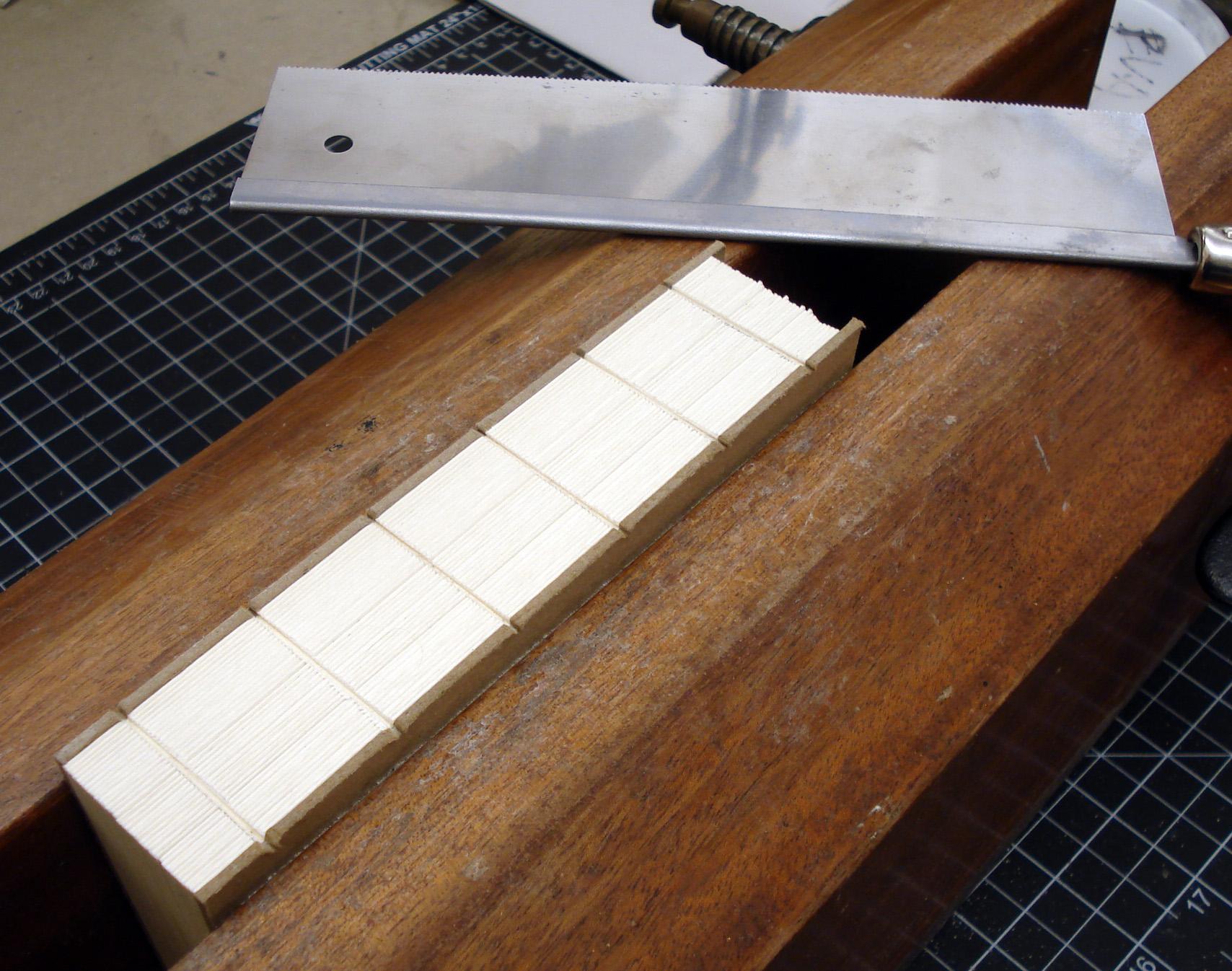 http://henryhebert.net/2011/11/16/german-paper-bindings-the-lapped-component/